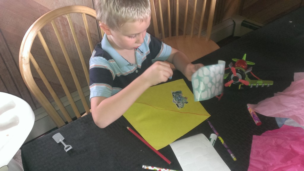 Kindergartner working on project at table. | mommycrusader.com