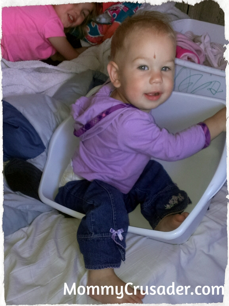Hiding in the laundry bins | MommyCrusader.com