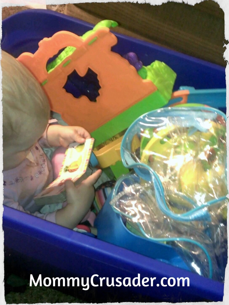 Hiding in the toy box| MommyCrusader.com