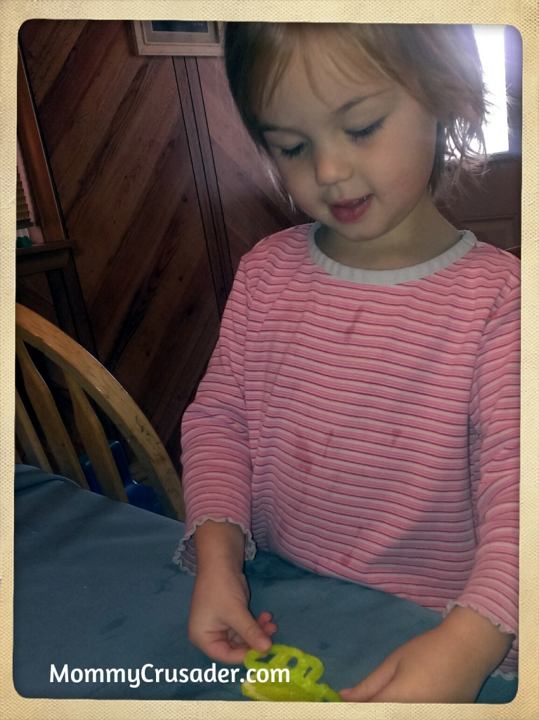 Preschooler working on her pretty pony craft. | MommyCrusader.com
